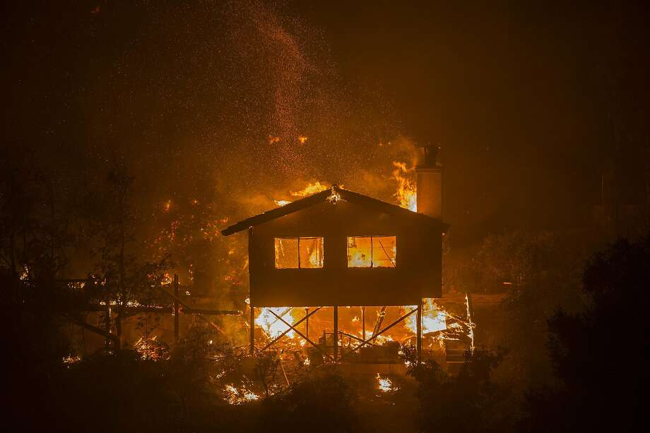 A structure burns at the Lilac Fire in the early morning hours of December 8, 2017 near Bonsall, California. Strong Santa Ana winds are pushing multiple wildfires across the region, expanding across tens of thousands of acres and destroying hundreds of homes and structures. Photo: David McNew, Getty Images