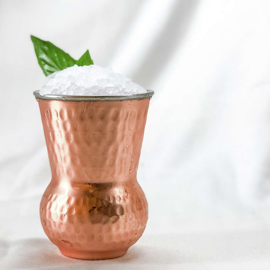 Bam Bam JulepRestaurant:Bam BamAirport:Bush Intercontinental, Terminal CIngredients:A fresh take on a Southern favorite with Jim Beam bourbon sweetened with maple syrup and fresh Thai basil. Photo: Houston Airport System