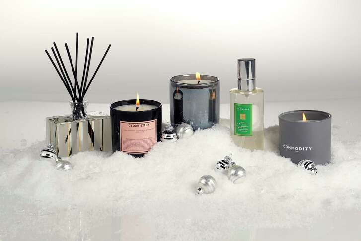 """(l-r) Nest """"Holiday"""" diffuser, Boy Smells """"Cedar Stack"""" candle, Lafco """"Starry Night"""" candle, Jo Malone London """"Pine & Eucalyptus"""" room spray, and Commodity """"Tonka"""" candle, photographed in the Houston Chronicle studio, Tuesday, Nov. 21, 2017, in Houston.  ( Karen Warren / Houston Chronicle )"""