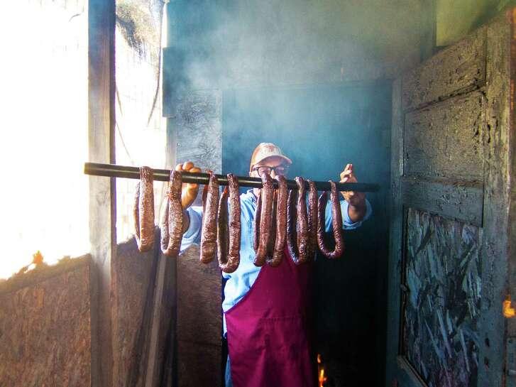 Arthur Yarbough checks house-made beef links atCaroline's Quality & Quantity in Kountze.