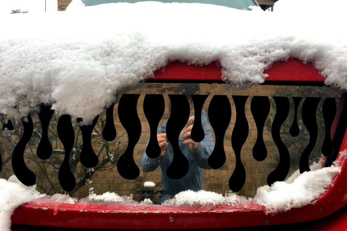 Snow on a flame truck grill. Ryan Pelham/The Enterprise