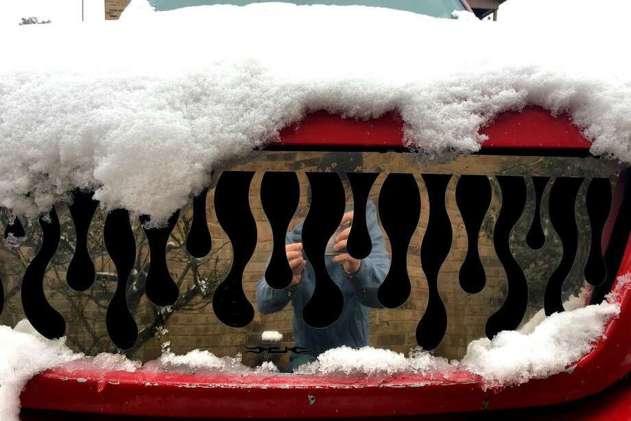 Snow on a flame truck grill.Ryan Pelham/The Enterprise Photo: BE