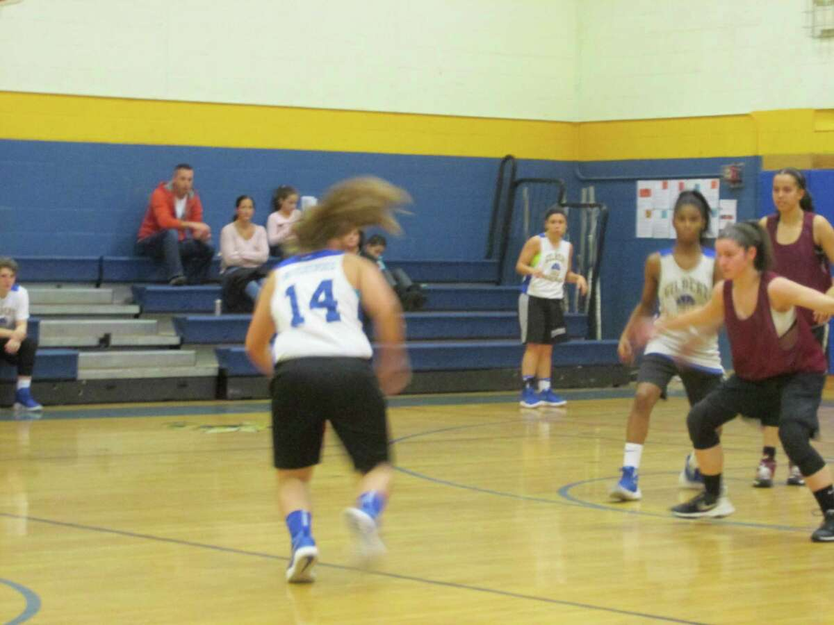 Torrington, in red shirts, and Gilbert crossed leagues for a preseason girls basketball scrimmage at the Gilbert School Wednesday afternoon.