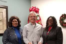 Deja Carter, left, and Lena Buck, right, of Anointed Women Ministry, Inc. pose with executive director of Family