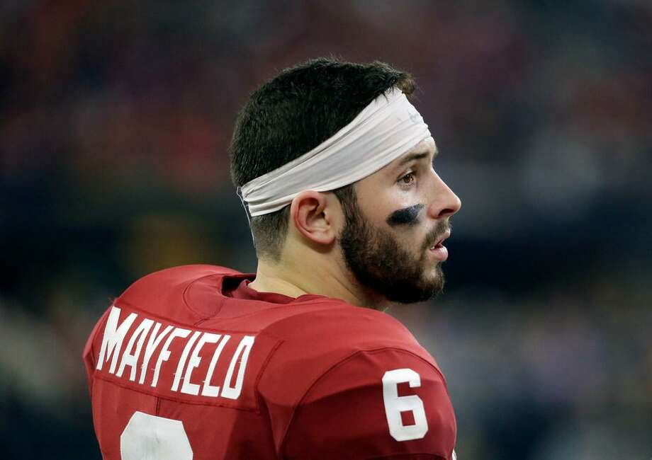 Oklahoma quarterback Baker Mayfield (6) stands on the sideline watching play against TCU in the second half of the Big 12 Conference championship NCAA college football game, Saturday, Dec. 2, 2017, in Arlington, Texas. Photo: Tony Gutierrez /AP Photo