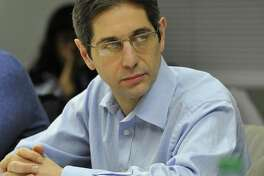 Frank Cerasoli, (R-15) looks on during the Board of Representatives' Pre-Steering meeting at the Stamford Government Center in Stamford, Conn., on Monday, Dec. 8, 2014.