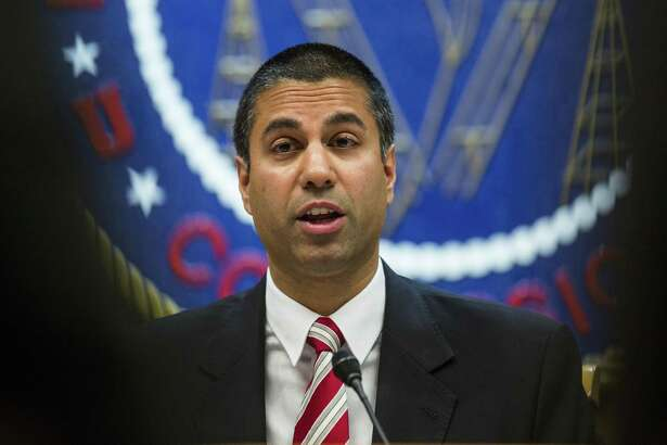 Ajit Pai, chairman of the Federal Communications Commission (FCC), speaks during an open meeting in Washington, D.C., U.S., on Thursday, Nov. 16, 2017. The FCC plans to vote in December to kill the net neutrality rules passed during the Obama era. Photographer: Zach Gibson/Bloomberg