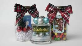 The Mason jar surprise Here's a goodie that pops up a lot on Pinterest. Stick a gift card into a Mason jar or similar glass jar filled with M&M's or other loose candy that grabs your sweetie's sweet tooth. Put a bow on the lid or decorative ribbon around the jar. Or make a waterless snow globe. Just place cotton balls or white shredded paper for snow in the bottom of the jar, then tuck in the gift card with a miniature brush tree or two and some miniature ornaments. You can also glue some of those teeny ornaments to the top of the lid.