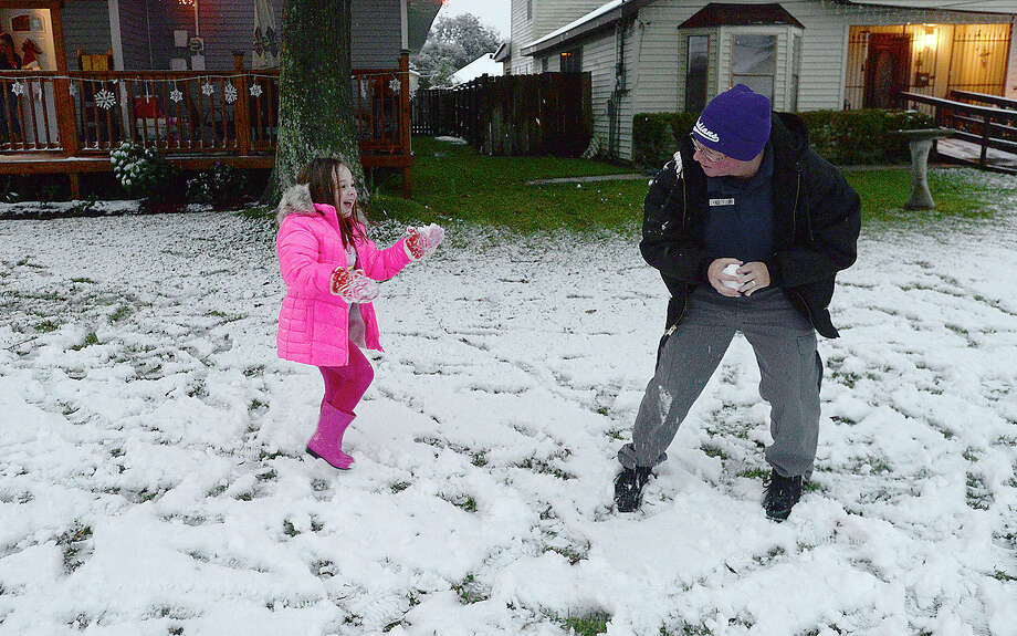 Callie Squires gets into a snowball fight with neighbor Tammy Clark outside her home in Nederland as wintry conditions brought snow to the region Friday.  Photo taken Friday, December 8, 2017 Kim Brent/The Enterprise Photo: Kim Brent / BEN