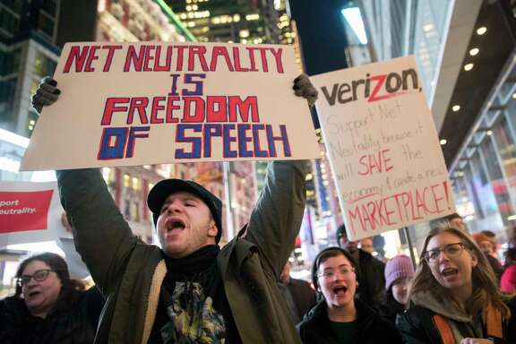 Demonstrators rally in support of net neutrality outside a Verizon store, Thursday, Dec. 7, 2017, in New York. The FCC is set to vote Dec. 14 whether to scrap Obama-era rules around open internet access that prevent phone and cable companies from favoring certain websites and apps.