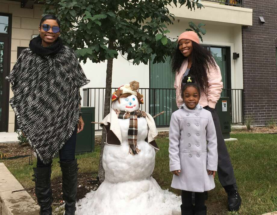 Riece Harris, Miss-Theresa Harris and Kylie-Rose Harris took about three hours to build and accessorize this snow-woman. Photo: Francisca Ortega