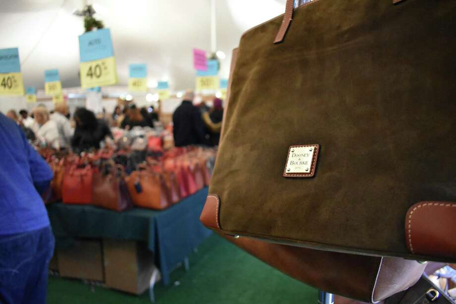 Once a year, handbags designed by Dooney & Bourque are sold in Norwalk, Conn. where the company has designed and crafted bags since 1975, thanks to an annual factory tent sale brought back in advance of the 2017 holiday season. Photo: Alexander Soule / Hearst Connecticut Media / Stamford Advocate