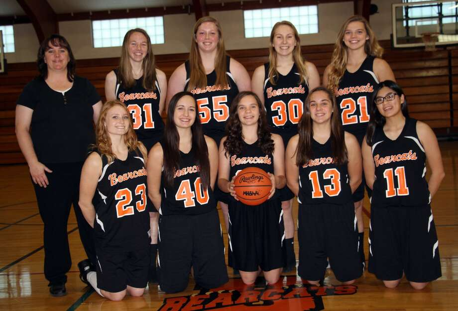 Members of the Ubly girls basketball team are (front row from left) Ariana Kaczor, Emelia Rodriguez, Josie Gusa, Haili Gusa and Olivia Bender (back row) coach Jeanne Gusa, Janelle White, Katelyn Sweeney, Ashley Puvalowski and Kara Peruski.  Photo: Seth Stapleton/Huron Daily Tribune