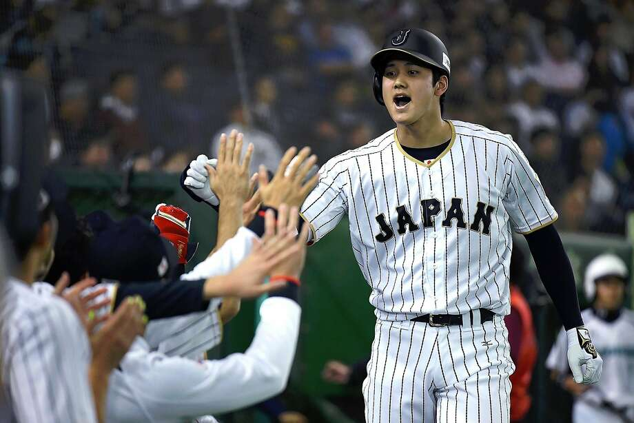 Shohei Ohtani #16 of Japan celebrates after hitting a solo homer in the fifth inning during the international friendly match between Japan and Netherlands at the Tokyo Dome on November 12, 2016 in Tokyo, Japan.  (Photo by Masterpress/Getty Images) Photo: Masterpress, Getty Images