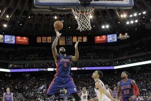 Andre Drummond (0) puts up a shot after recovering a loose ball in the first half. The Golden State Warriors played the Detroit Pistons at Oracle Arena in Oakland, Calif., on Wednesday, March 11, 2015.
