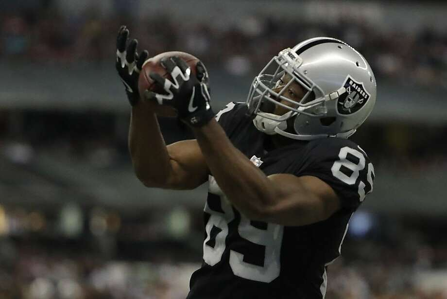 Oakland Raiders wide receiver Amari Cooper makes a catch during the second half of an NFL football game against the New England Patriots Sunday, Nov. 19, 2017, in Mexico City. (AP Photo/Rebecca Blackwell) Photo: Rebecca Blackwell, Associated Press