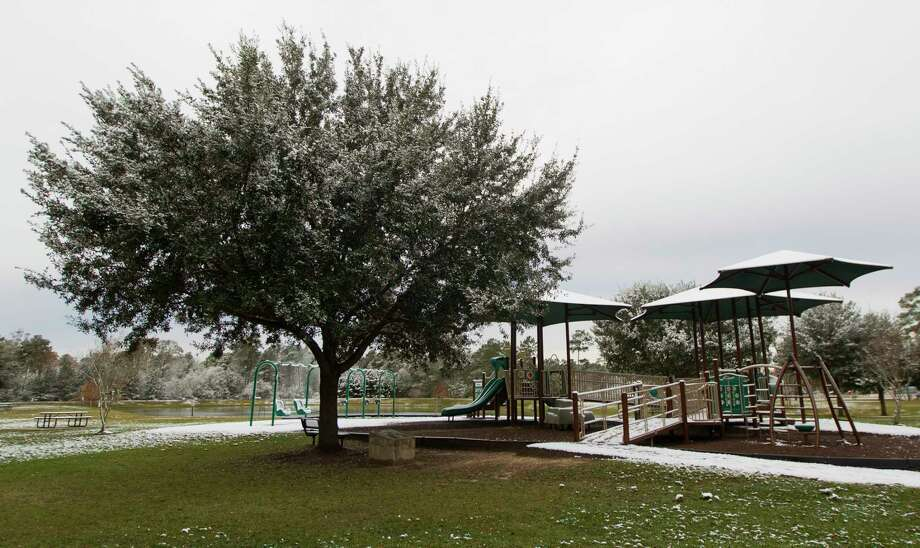 The tree next to the playground at Carl Barton Jr. Park was planted on Dec. 27, 2004 on the 100th anniversary of Conroe's incorporation. A plaque recognizes the Conroe Centennial Committee and the 100th anniversary of the town. The Centennial Tree was captured on Friday morning after a dusting of snow fell overnight. Photo: Jason Fochtman, Staff Photographer / © 2017 Houston Chronicle