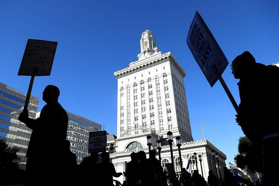 Oakland city workers, shown picketing Tuesday outside City Hall, began striking this week over pay. The city wants the union to agree to state mediation to resolve the labor dispute. Photo: Justin Sullivan, Getty Images
