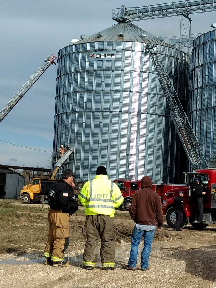 Crews from 14 Liberty County fire departments are working nonstop on Friday afternoon, removing burning rice from one of the Raywood, Texas rice dryers owned by American Rice Growers. Photo: Vanesa Brashier