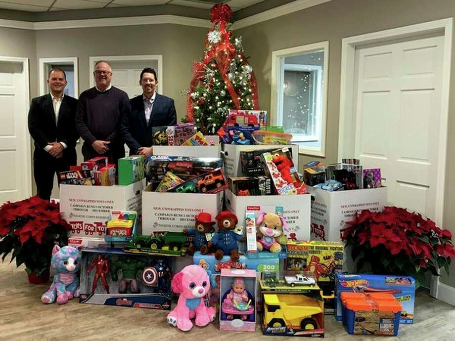 Raymond James recently hosted more than 250 people at China King in Bad Axe. Attendees were asked to bring a toy to the event for local children in need. Raymond James' clients brought in over 500 gifts throughout the day. Pictured are financial advisors Ty Colling, Mark Krug and Jason Krohn. (Submitted Photo)