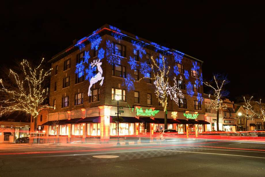 Betteridge jewelers took a page straight out of the iconic holiday lights displays on Manhattan's Fifth Avenue during a holiday party Dec. 7, 2017 in Greenwich. These long exposure photos show the flow of traffic on Greenwich Avenue and Elm Street past a decked out Betteridge. Photo: Neil Vigdor