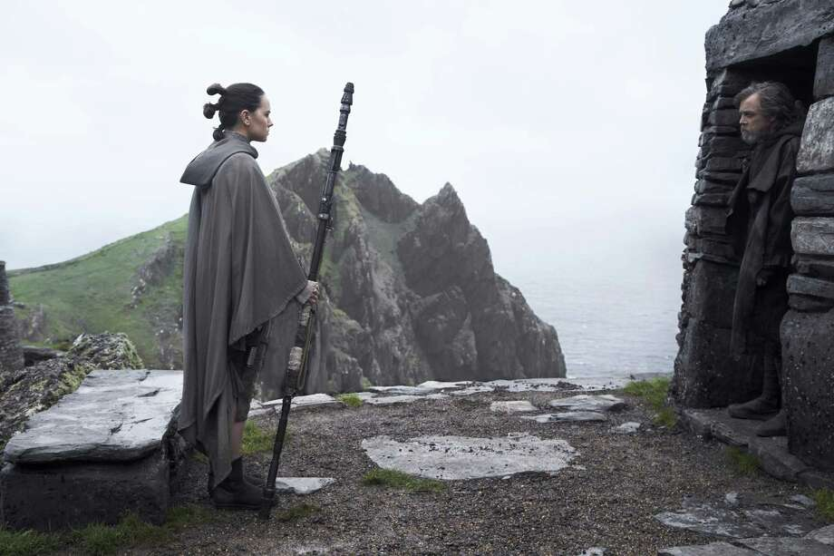 """Daisy Ridley, as Rey, and Mark Hamill, as Luke Skywalker, appear in a scene from """"Star Wars: The Last Jedi."""" The film will be screened at the IMAX Theater at The Maritime Aquarium at Norwalk, Dec. 14 through Jan. 15. Photo: Jonathan Olley / Contributed Photo / Copyright: 2016 Lucasfilm Ltd. &™, All Rights Reserved."""