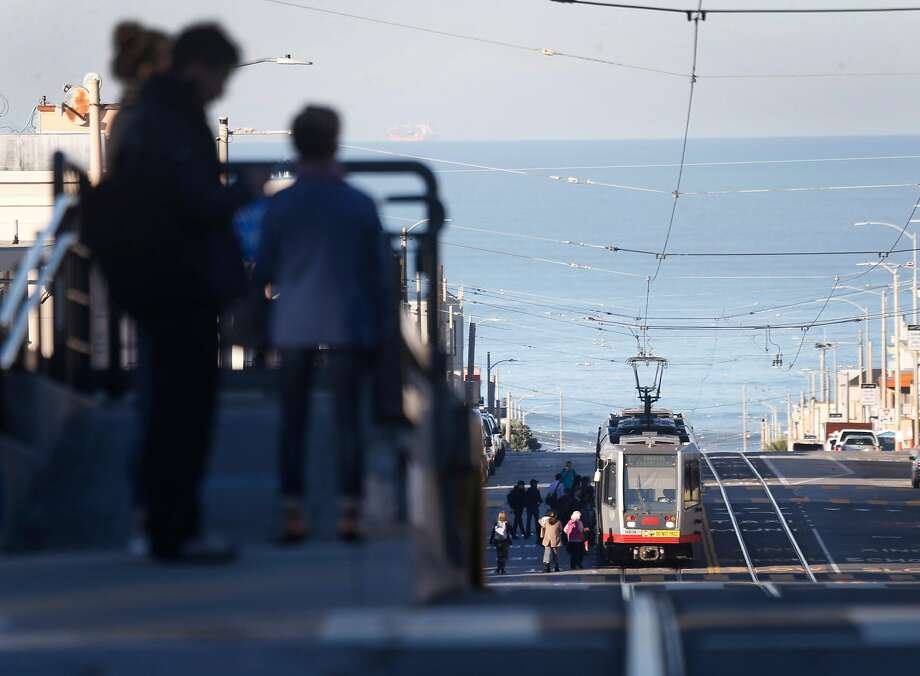 Passengers wait for an L-Taraval Muni Metro streetcar from a raised platform at Sunset Boulevard in San Francisco, Calif. on Wednesday, Dec. 6, 2017. SFMTA plans on installing other raised concrete boarding areas at stops on Taraval at 26th, 30th, 32nd and 40th avenues. Photo: Paul Chinn, The Chronicle