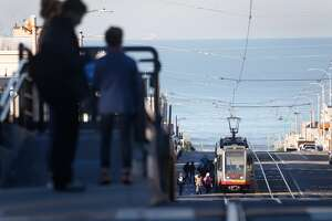 Passengers wait for an L-Taraval Muni Metro streetcar from a raised platform at Sunset Boulevard in San Francisco, Calif. on Wednesday, Dec. 6, 2017. SFMTA plans on installing other raised concrete boarding areas at stops on Taraval at 26th, 30th, 32nd and 40th avenues.