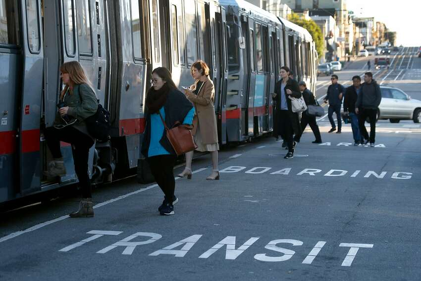 Passengers board an inbound L-Taraval Muni Metro streetcar from a street level boarding area at Taraval Street and 32nd Avenue in San Francisco, Calif. on Wednesday, Dec. 6, 2017.