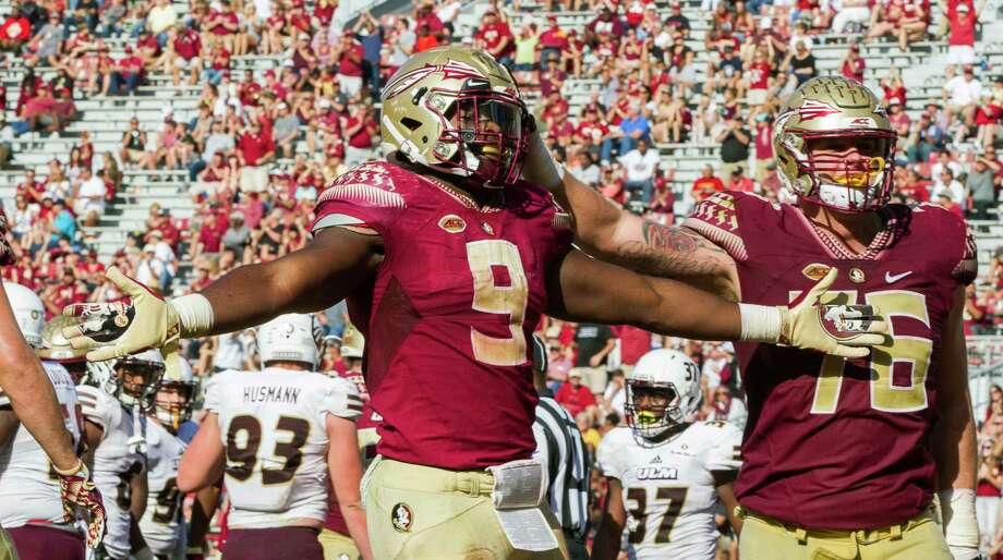 8d54ff0ca Florida State running back Jacques Patrick (9) and offensive lineman Rick  Leonard celebrate Patrick s
