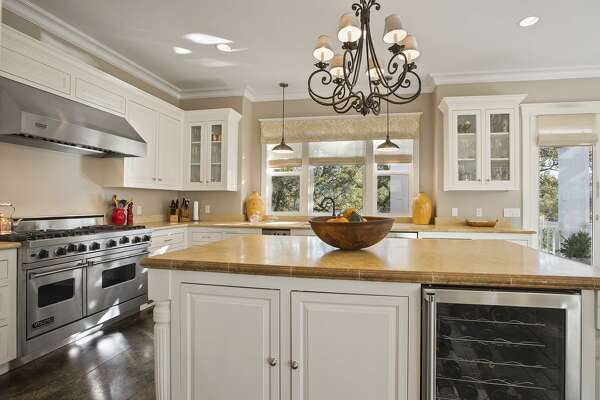 The kitchen hosts professional appliances and access to a side deck.