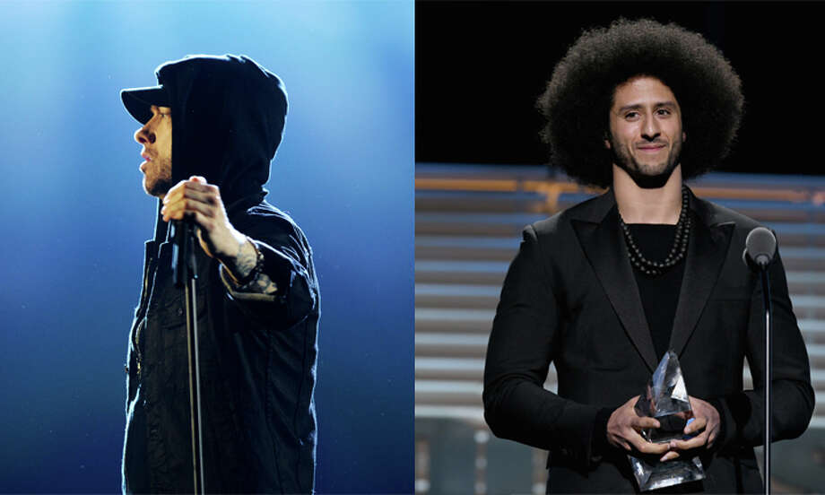 """Eminem gave Colin Kapernick a shout out in his latest single """"Untouchable"""" from his upcoming album """"Revival.""""It's been a pretty busy couple weeks for Kaepernick. He was named the GQ """"Citizen of the Year"""" and received Sports Illustrated's Muhammad Ali Legacy Award.Browse through the photos too see how people reacted to Kaepernick receiving the Muhammad Ali Legacy Award from SI. Photo: Slaven Vlasic/ Dave J Hogan / Getty Images"""