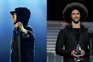 "Eminem gave Colin Kapernick a shout out in his latest single ""Untouchable"" from his upcoming album ""Revival.""  It's been a pretty busy couple weeks for Kaepernick. He was named the GQ  ""Citizen of the Year""  and received Sports Illustrated's  Muhammad Ali Legacy Award.    Browse through the photos too see how people reacted to Kaepernick receiving the Muhammad Ali Legacy Award from SI."