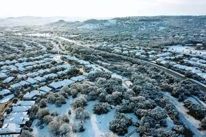 Drue Placette put his drone in action Friday morning to show how a light sprinkling of snow turned portions of San Antonio into a winter wonderland.