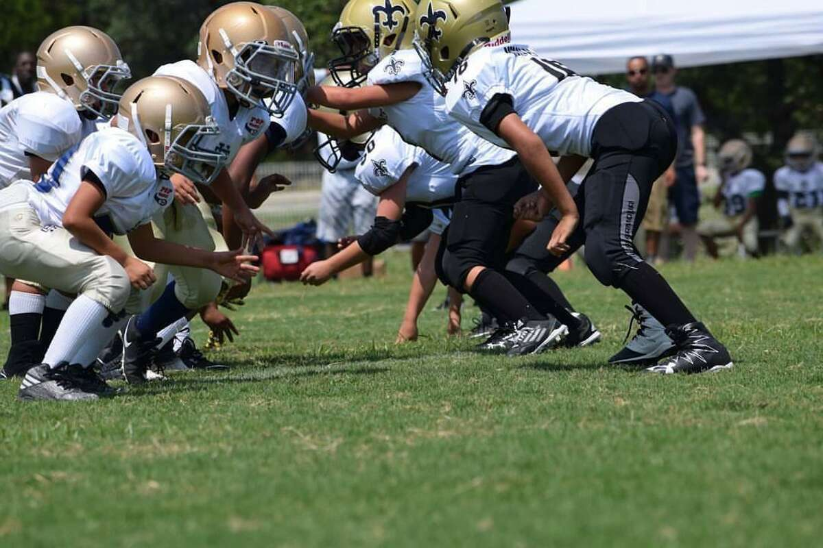 San Antonio Saints youth football team in action.