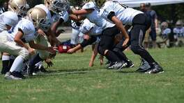San Antonio Saints youth football team in action.