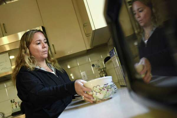 Kids in Crisis Clinical Director Kimberly Wolfson-Lisack works in the kitchen of the children's house at the Kids in Crisis headquarters in Cos Cob.
