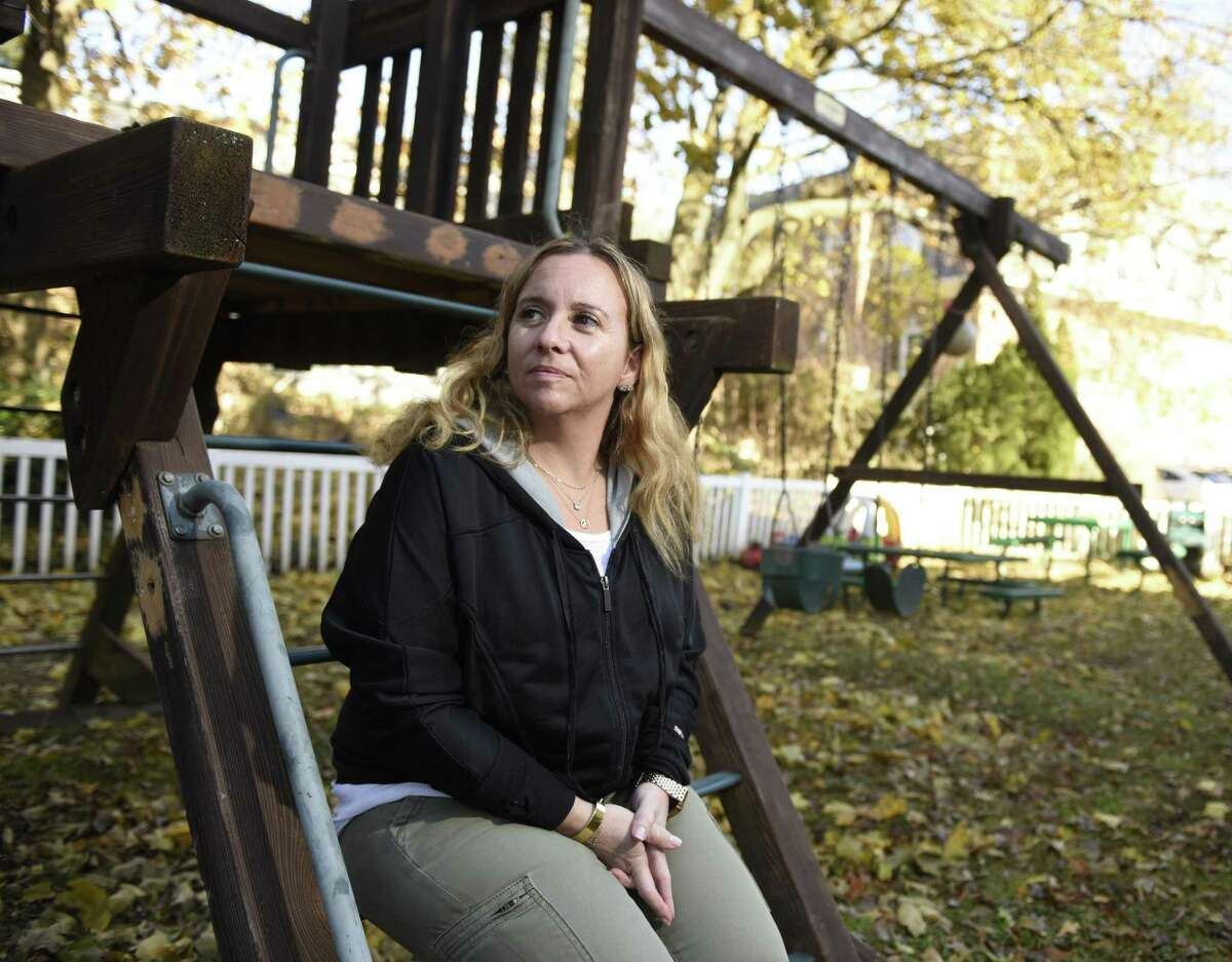 Kids in Crisis Clinical Director Kimberly Wolfson-Lisack sits outside the Kids in Crisis headquarters in Cos Cob.