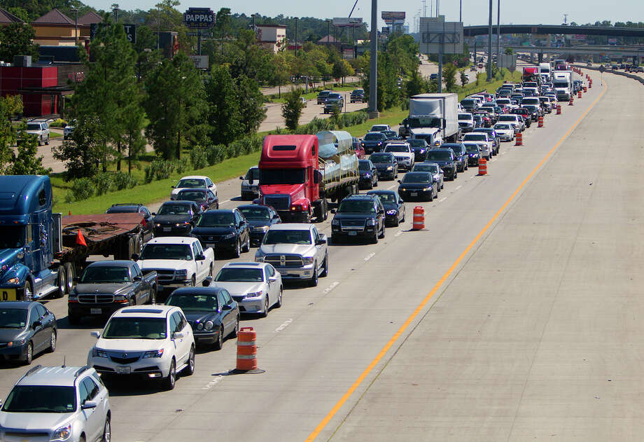 Traffic backs up along 45 near Lake Woodlands Drive on Oct. 4, 2014, in Conroe. Widening work along the freeway has moved north to Huntsville. Photo: Cody Duty, Houston Chronicle / © 2014 Houston Chronicle
