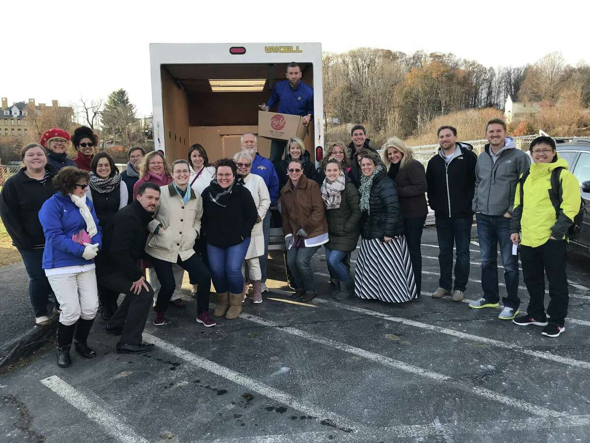 The Gilbert School in Winsted helped pack Thanksgiving donations just before the holiday, helping people in need.