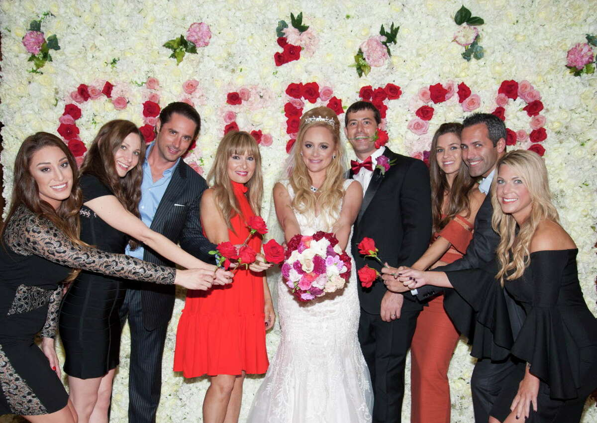 """""""Bachelor Nation"""" descended upon Houston for reality star Erica Rose's wedding day. The Bayou City native asked her now-husband Charles Sanders to propose to her daughter, Holland Gentry, too; Rose and Gentry walked down the aisle at Congregation Emanu El together. Rose and Sanders, who first met in high school, celebrated with not one, but two fun-filled receptions. The second party took place downtown at the Majestic Metro."""