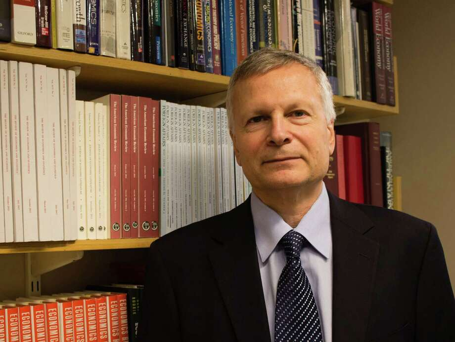 "This Sept. 15, 2016, photo provided by Jessica De Simone shows author Dani Rodrik at his office at the Harvard Kennedy School in Cambridge, Mass. In Rodrik's new book, ""Straight Talk on Trade: Ideas for a Sane World Economy,'' Rodrik argues that most economists long ignored what their own scholarship had made clear: That global free trade, for all its benefits, inevitably ends up depressing some industries and communities. (Jessica De Simone via AP) Photo: Jessica De Simone, HONS / Jessica De Simone"