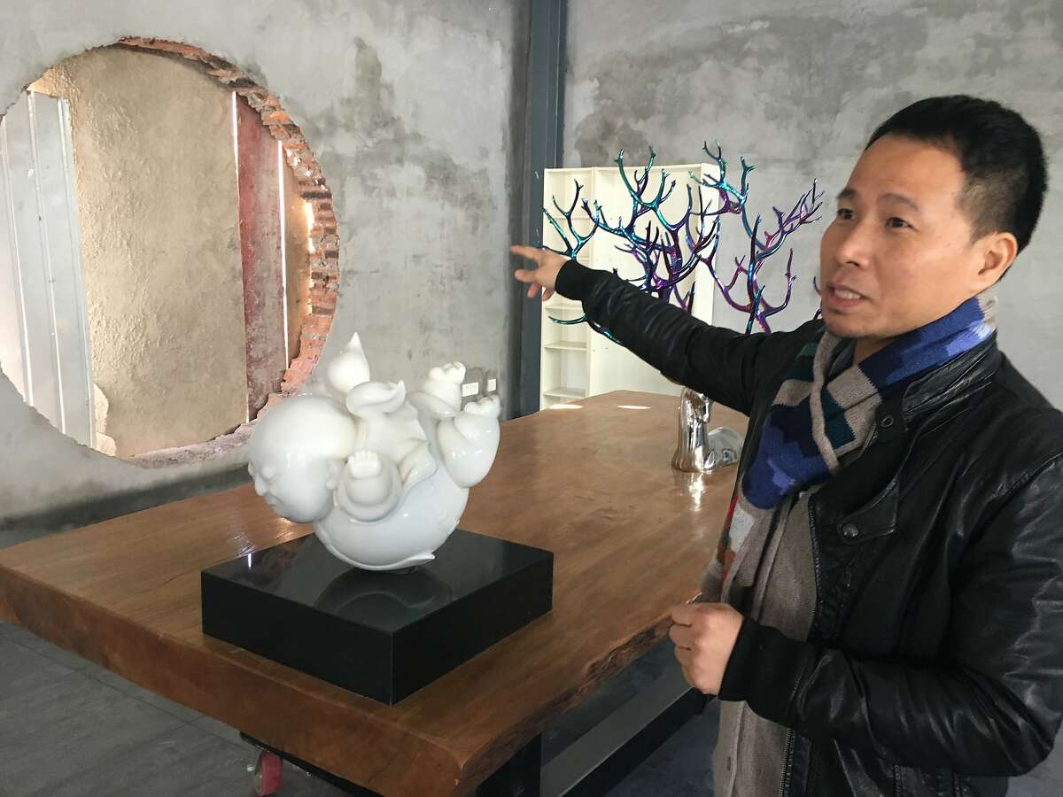Artist Giao Xiaowu gives a tour of his new studio on a tour arranged by the Peninsula Hotel, Beijing, which also displays his sculptures.