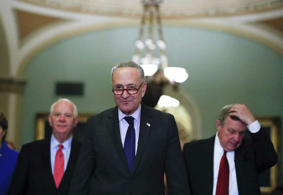 Senate Minority Leader Chuck Schumer (center) prepares to address the media on Capitol Hill, accompanied by Sens. Ben Cardin (left) and Dick Durbin. A reader brands Schumer and Durbin hypocrites for shifting their attitude toward sexual misconduct over the years. Photo: Alex Brandon /Associated Press / Copyright 2017 The Associated Press. All rights reserved.