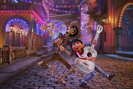 """In this image released by Disney-Pixar, character Hector, voiced by Gael Garcia Bernal, left, and Miguel, voiced by Anthony Gonzalez, appear in a scene from the animated film, """"Coco."""""""