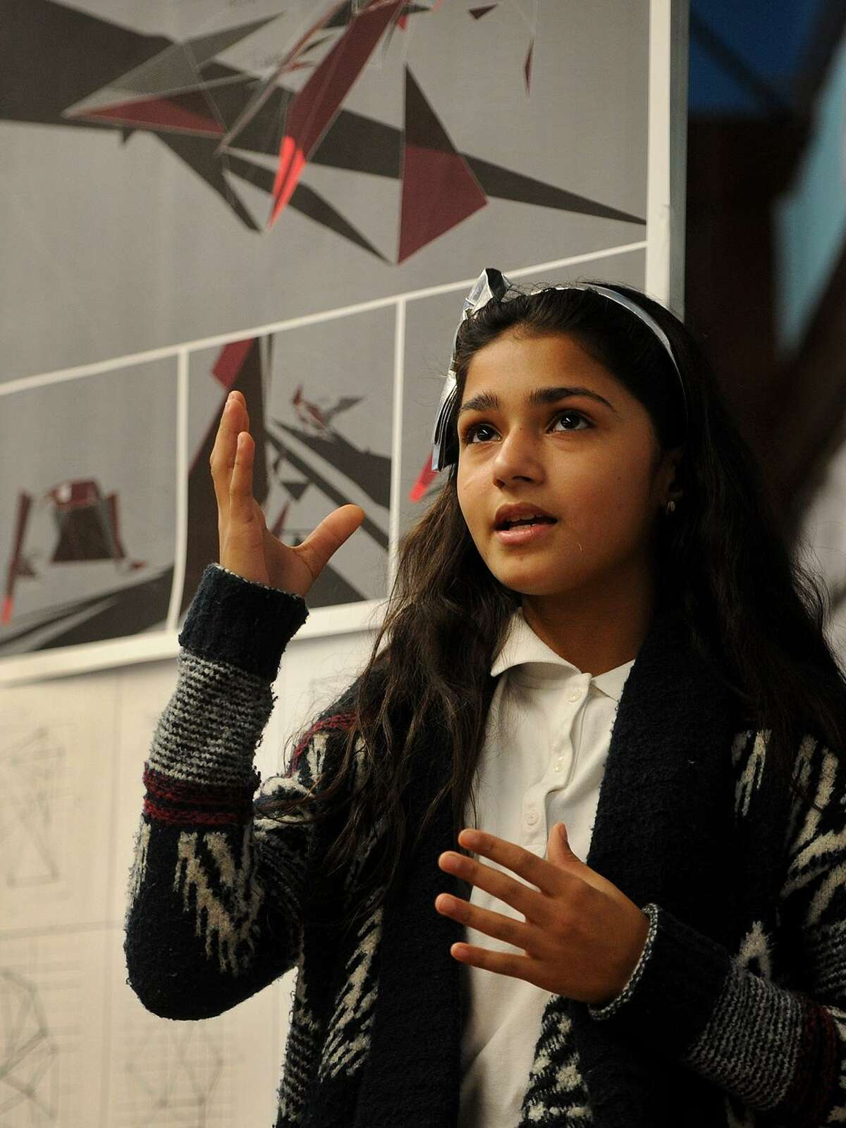 Sixth grader Milayna Roman, 11, presents her architecture project that she completed as part of the Thom Mayne Young Architects program at Hall School in Bridgeport, Conn. on Tuesday, December 5, 2017. Students learned to use a computer design program to artistically reimagine their classroom space.