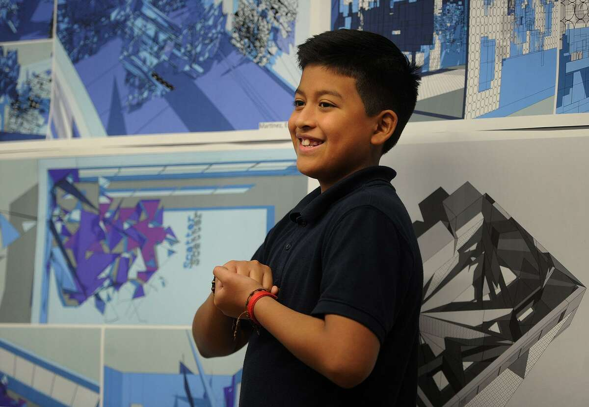 Sixth grader Joel Gonzalez-Lituma, 11, presents his architecture project that he completed as part of the Thom Mayne Young Architects program at Hall School in Bridgeport, Conn. on Tuesday, December 5, 2017. Students learned to use a computer design program to artistically reimagine their classroom space.
