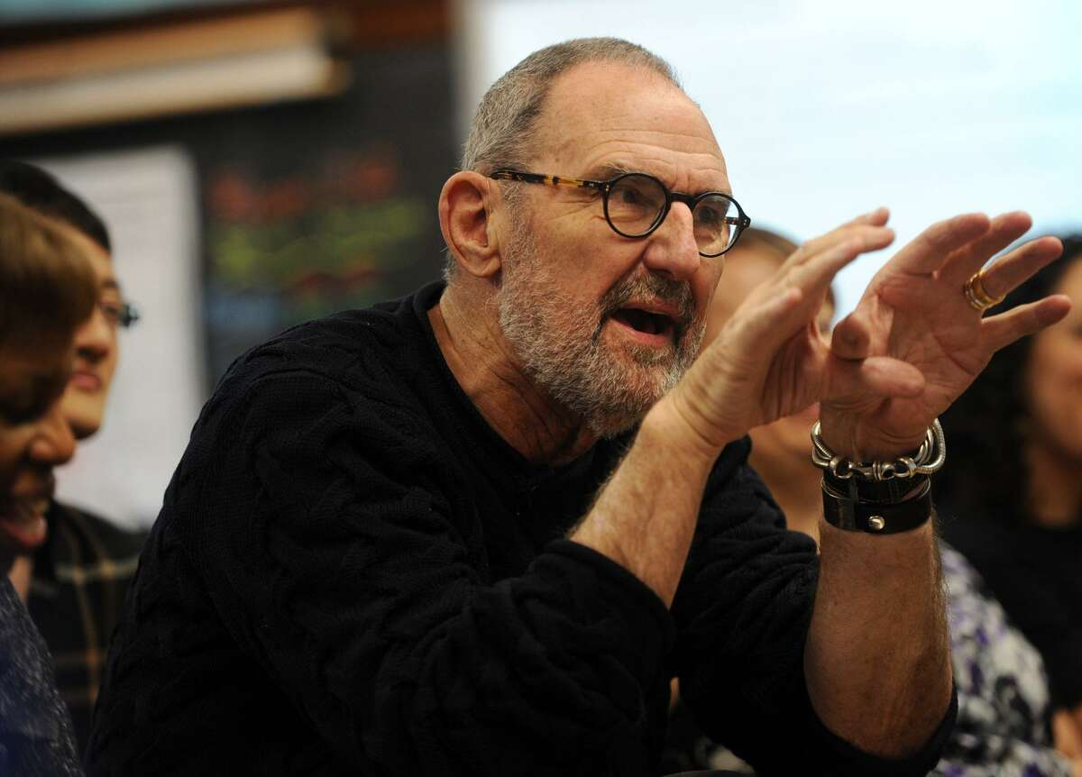 Architect Thom Mayne provides comments to sixth grade students on their architecture projects at Hall School in Bridgeport on Tuesday. Mayne is the Turnaround Arts mentor at the school.