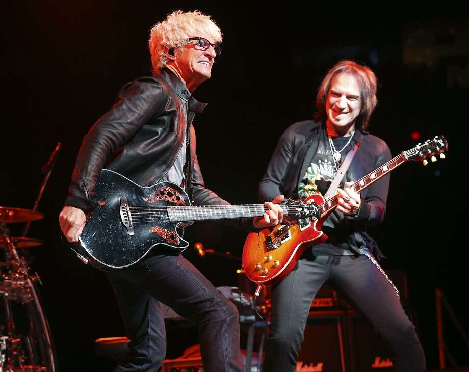 Guitarists Kevin Cronin, left, and Dave Amato rock with their band, REO Speedwagon, at the AT&T Center in 2013. A reader defends both this band and Pet Benatar, who are headling the Tricentennial performance on New Year's Eve. Photo: TOM REEL /San Antonio Express-News / San Antonio Express-News