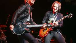 Guitarists Kevin Cronin, left, and Dave Amato rock with their band, REO Speedwagon, at the AT&T Center in 2013. A reader defends both this band and Pet Benatar, who are headling the Tricentennial performance on New Year's Eve.